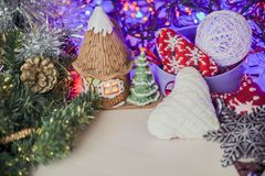 Christmas table decoration 2018,Christmas balls with fir branch and candle on wooden background Royalty Free Stock Image
