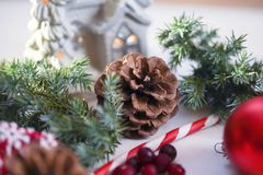 Christmas table decoration 2018,Christmas balls with fir branch and candle on wooden background Royalty Free Stock Photo