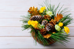 Christmas table decoration with pine branches and golden cones Royalty Free Stock Photos