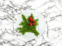 Christmas table decoration. Pine branches red berries Stock Photos