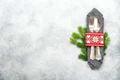 Christmas table decoration pine tree brunches stone background. Christmas table decoration with pine tree brunches on grey stone background stock photos