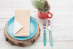 Christmas table decoration with plate, fork, knife, menu card, green fir twig Royalty Free Stock Image