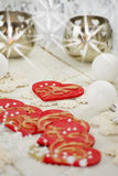 Christmas table decoration with red hearts. Christmas table decoration with candle hearts ornament bauble pearls moody Royalty Free Stock Images