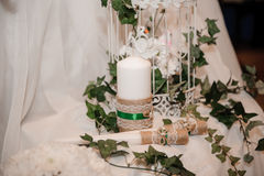 Christmas table decoration in white and green Royalty Free Stock Images