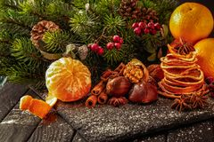 Christmas table and decorations, fruits, nuts, tangerines, dried oranges stock photos