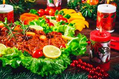 Christmas table dinner time with roasted meats, candles and New Year décor. Background thanksgiving day. Stock Images