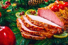 Christmas table dinner time with roasted meats, candles and New Year décor. Background thanksgiving day. Royalty Free Stock Photography