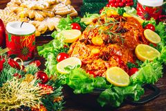 Christmas table dinner time with roasted meats, candles and New Year décor. Background thanksgiving day. The concept of a family holiday, Beautiful delicious Stock Photo