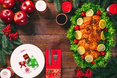 Christmas table dinner time with roasted meats, candles and New Year decor. Background thanksgiving. Christmas table dinner time with roasted meats decorated in stock photography