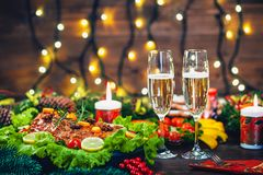 Thanksgiving day. Christmas table dinner time with roasted meats decorated in Christmas style. The concept of a family holiday Stock Image