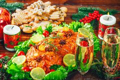 Thanksgiving day. Christmas table dinner time with roasted meats decorated in Christmas style. The concept of a family holiday Royalty Free Stock Images