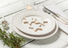 Christmas table - elegant white plate with cookies from above Royalty Free Stock Image