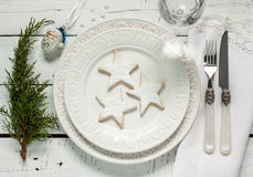 Christmas table - elegant white plate with cookies from above Royalty Free Stock Photography