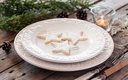 Christmas table - elegant white plate with cookies Stock Photo
