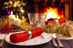 Christmas table with fireplace in the background Stock Image