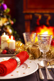 Christmas table with fireplace and Christmas tree in the back Stock Photos