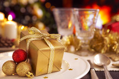 Christmas table with fireplace and Christmas tree in the backgro Stock Images
