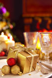 Christmas table with fireplace and Christmas tree Stock Photography