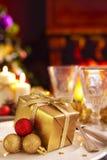 Christmas table with fireplace and Christmas tree Stock Photography