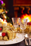 Christmas table with fireplace and Christmas tree Stock Photos