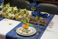 Christmas table with flower arrangement Royalty Free Stock Photo