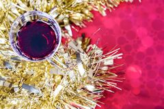 Christmas table with glass of red wine, closeup, top view. royalty free stock image