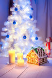 Christmas table with homemade gingerbread cottage Stock Photo