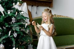 Christmas table: knife and fork, napkin and Christmas tree branch on a wooden table . New Year`s decor of the festive table. Christmas background Royalty Free Stock Photo