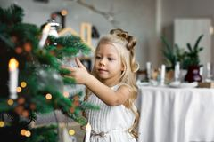 Christmas table: knife and fork, napkin and Christmas tree branch on a wooden table . New Year`s decor of the festive table. Christmas background Stock Photography