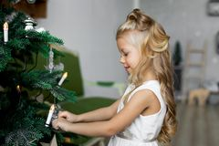 Christmas table: knife and fork, napkin and Christmas tree branch on a wooden table . New Year`s decor of the festive table. Christmas background Stock Image