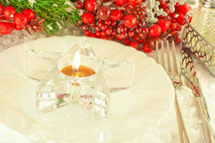 Christmas table layout, candlestick in the form of Royalty Free Stock Photos