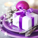 Christmas table place with gift Royalty Free Stock Image