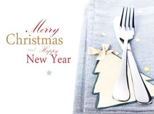 Christmas table place setting with christmas decorations in silv Stock Images