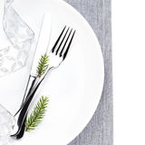 Christmas table place setting with christmas decorations  in whi Royalty Free Stock Photo