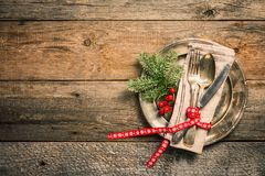 Christmas table place setting. On wooden background, top view with copy space. Holidays background Stock Image