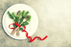 Christmas table place setting decoration copy space. Christmas table place setting decoration on stone background with copy space stock photos