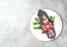 Christmas table place setting decoration grey background. Christmas table place setting decoration with pine tree brunches on grey background royalty free stock photos
