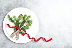 Christmas table place setting decoration pine tree brunches. Christmas table place setting decoration with pine tree brunches on grey background royalty free stock photos
