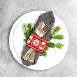 Christmas table place setting decoration Square image. Christmas table place setting decoration with pine tree brunches. Square image stock photos