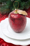 Christmas table place setting with a decorative apple, close-up Stock Photo