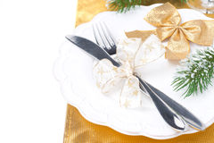 Christmas table place setting in golden tones, isolated on white Royalty Free Stock Photos