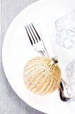 Christmas table place setting with holiday  ornaments and copy s Stock Photography