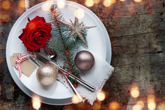 Christmas table place setting on old wooden Table Royalty Free Stock Image