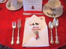 Christmas table place setting with ornate holiday decorations stock photo