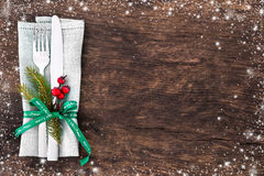 Christmas table place setting. With christmas pine branches,ribbon and bow. Christmas holidays background Stock Photography