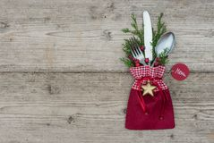 Christmas background with silverware place setting for festive holiday dinner. Christmas table place setting with rustic cutlery decoration and tag with text royalty free stock photos