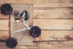 Christmas table place setting and silverware ,pine cones with sp Stock Image