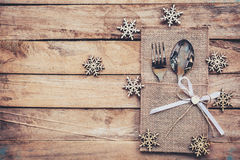 Christmas table place setting and silverware, snowflakes on wood Stock Image