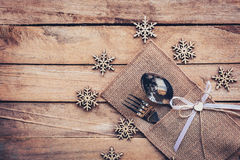 Christmas table place setting and silverware, snowflakes on wood Royalty Free Stock Images