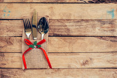 Christmas table place setting and silverware on wood with space Royalty Free Stock Photos
